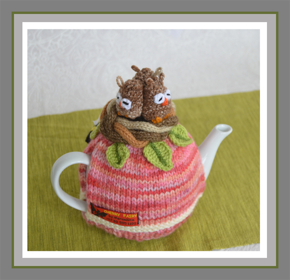 three owls in a nest tea cosy image