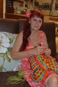Designer Marcelline Simonotti with her Paint Box Baby Blanket just finished